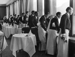 Waiters+all+look+out+of+window